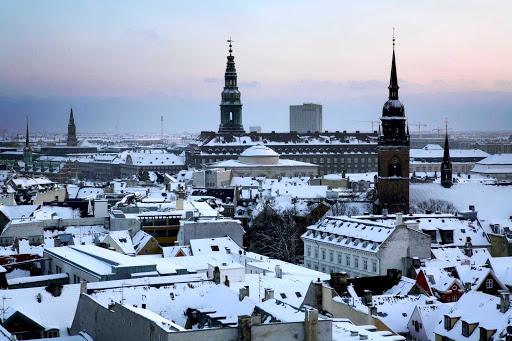 rooftops-of-Copenhagen-in-winter - Snow-covered rooftops of Copenhagen in winter.
