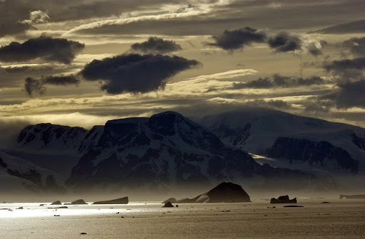 265d3LemaireStrait - Sunset at the Lemaire Strait. During the Antarctic summer, it never gets totally dark.
