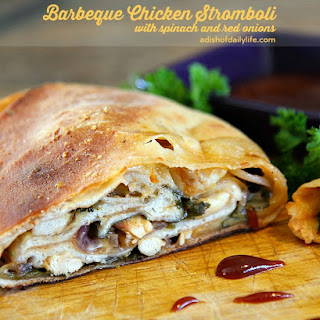 Barbeque Chicken Stromboli with spinach and red onions.