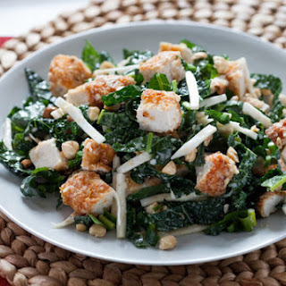 Parmesan-Crusted Chicken with Kale Caesar Salad and Toasted Hazelnuts