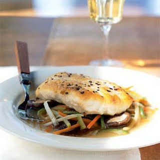 Striped Bass Fillet with Lobster Stock and Aromatic Vegetables.