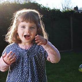 Playing in the garden by Adrian Stock - Babies & Children Child Portraits ( child, flash, ocf, backlit, girl, fun, smile, garden, portrait )