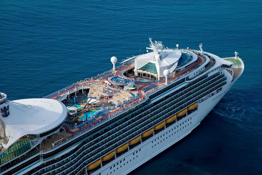 Navigator-of-the-Seas-aerial - The top view of Royal Caribbean's Navigator of the Seas. Hang out by the pool, try surfing on the FlowRider, watch movies and sporting events on a 220-square-foot outdoor screen, and stay connected with shipwide wi-fi.