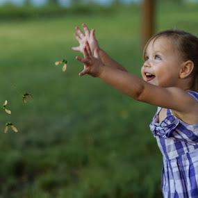 Throwing Mapleseeds by Craig Lybbert - Babies & Children Children Candids ( throw, girl, joy, happy, play, maple seeds )