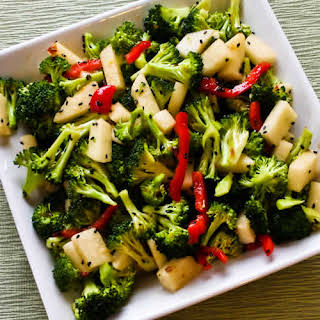 Spicy Broccoli-Jicama Salad with Red Bell Pepper and Black Sesame Seeds.