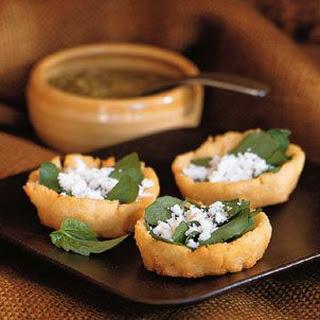 Crispy Potato Sopes (Masa Boats) with Salsa, Goat Cheese and Herb Salad.