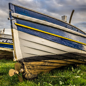 Done for the day by Ryan Bedingfield - Transportation Boats ( clouds, sky, propeller, grass, boat )