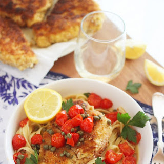Crispy Chicken Scallopini with Tomatoes in a Lemon-Butter White Wine Sauce.