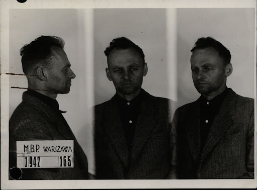 Witold Pilecki's prison photograph; photograph of prisoner No. 165/1947
