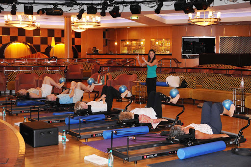 Spa-Fitness-Pilates-Reformer-Class-on-Crystal-Serenity - Take a Pilates Reformer class on Crystal Serenity to  get energized for your vacation!