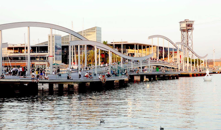 Barcelona's largest shopping destination, Maremàgnum Mall, overlooks the bay along the Mediterranean Sea.