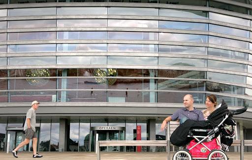 Copenhagen-Opera-House - A family pauses in front of the Opera House in Copenhagen, Denmark.