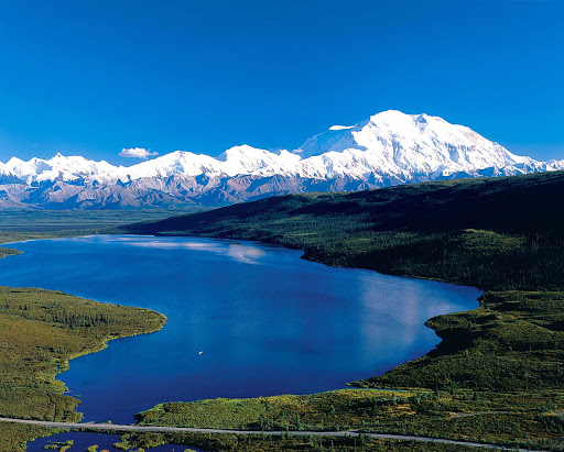 lake-mountain-Denali - Throughout the day, lakes and mountain vistas create beautiful landscapes in Denali National Park, Alaska.