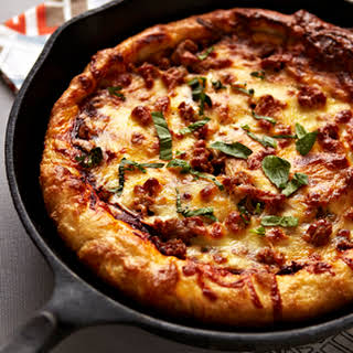 Cast Iron Baked Pizza with Sausage, Red Onions and Balsamic Herb Sauce.