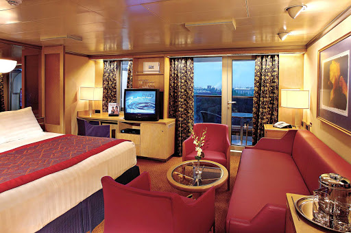 Holland-America-Vista-Class-Signature-Suite - A Signature Suite aboard your Holland America Line ship runs 273 to 456 square feet, which includes a private verdanda, one queen or two lower beds, bathroom with dual sink vanity, full-size whirlpool bath, sitting area and floor-to-ceiling windows.