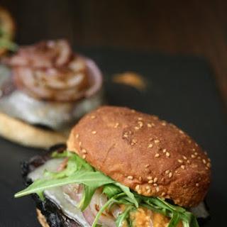 Grilled Portobello Mushroom Burgers with Romesco, Manchego and Arugula.