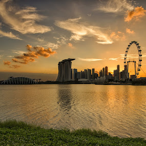 Dancing Clouds over the City by Kristianus Setyawan - Landscapes Cloud Formations ( clouds, waterscape, horizon, cloudscape, marina bay sands, cityscape, landscape, singapore, marina bay, cloud formations, reservoir, city view, sunset, landscape photography, singapore flyer, gardens by the bay, sunset scenery, city skyline )