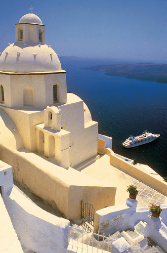 Seabourn_ship_in_Santorini_Greece - A Seabourn ship in the picture-postcard cruise haven of Santorini, Greece.