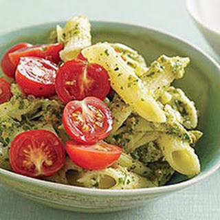 Almond-Herb Pesto Pasta with Artichoke and Tomato.