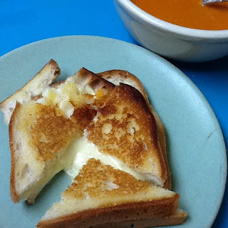 Grilled Kinnikinnick bread with Cabot cheddar cheese with red pepper tomato soup