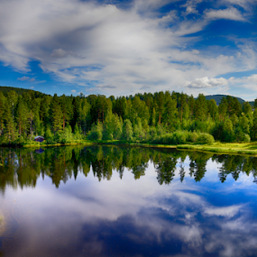 Calm lake reflection against the blue sky with white clouds by Maurizio Martini - Landscapes Waterscapes ( countryside, reflection, europe, wood, colorful, reflections, travel, beauty, north, landscape, sky, area, nature, lakeside, light, scandinavian, water, clouds, nordic, sweden, scandinavia, swedish, beautiful, lake, in, rural, country, northern, vacation, season, blue, background, outdoors, summer, scene, cloud, woodland, view, scenery, natural,  )