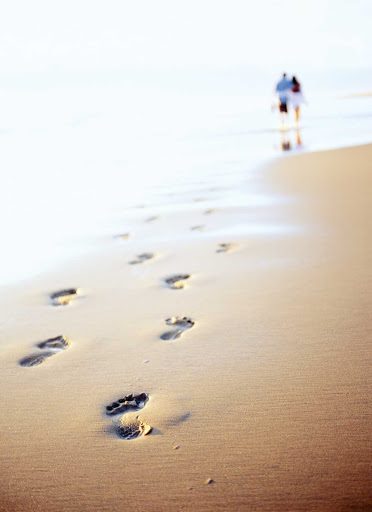 Windstar-Cruises-beach-footprints - Take a romantic stroll on a tropical beach during a Windstar cruise.