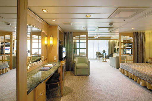 The Owner's Suite on Legend of the Seas offers a queen-size bed, private balcony, separate living area with queen-size sofa and other amenities.