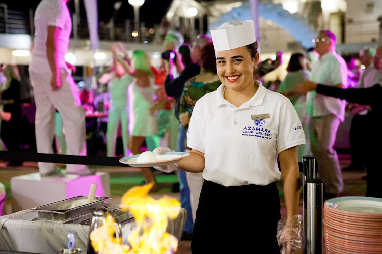 An Azamara Club Cruises crew member serves up a dish during a White Night party.