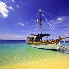 Docking on the beach by Marius Turc - Landscapes Travel ( sky, colors, ship, greece, sea, , water, device, transportation )