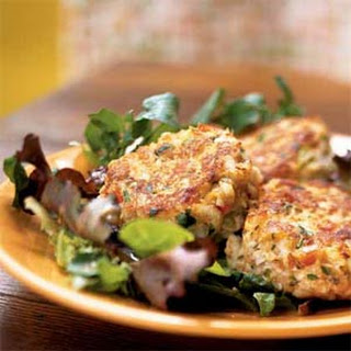 Crab Cakes on Mixed Greens with Peanut Vinaigrette.