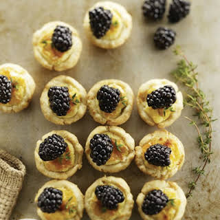 Mini Cheese Tarts with Blackberries.