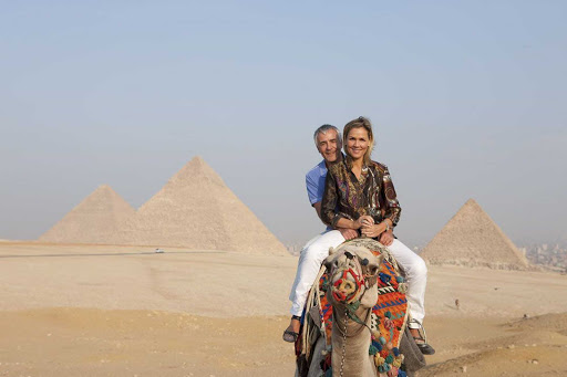 Uniworld-River-Cruises-Pyramids-of-Giza - Bucket list alert! Travel aboard Uniworld's River Tosca and explore the pyramids of Giza with a camel trek across the rolling sand dunes.