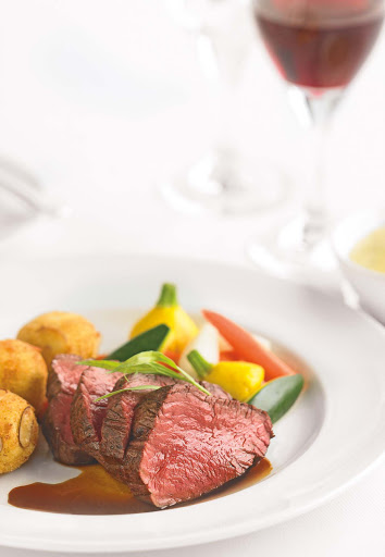 Chateubriand-dinner-Princess-Cruises - A Chateaubriand steak with vegetables served to guests on a Princess cruise.