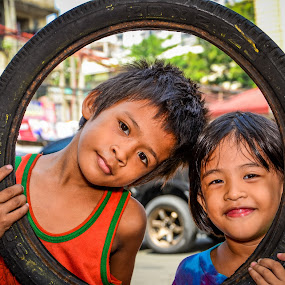 We share everything. by Morrie Lorena - Babies & Children Child Portraits ( malate, photowalk, scott kelby, rajah sulayman, , Travel, People, Lifestyle, Culture )