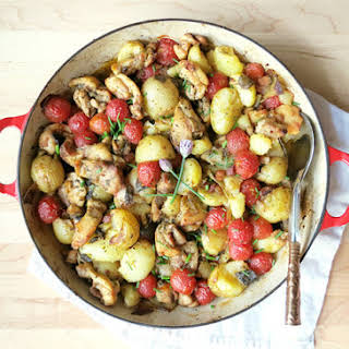 Chicken Thigh Casserole with New Potatoes and Tomatoes.