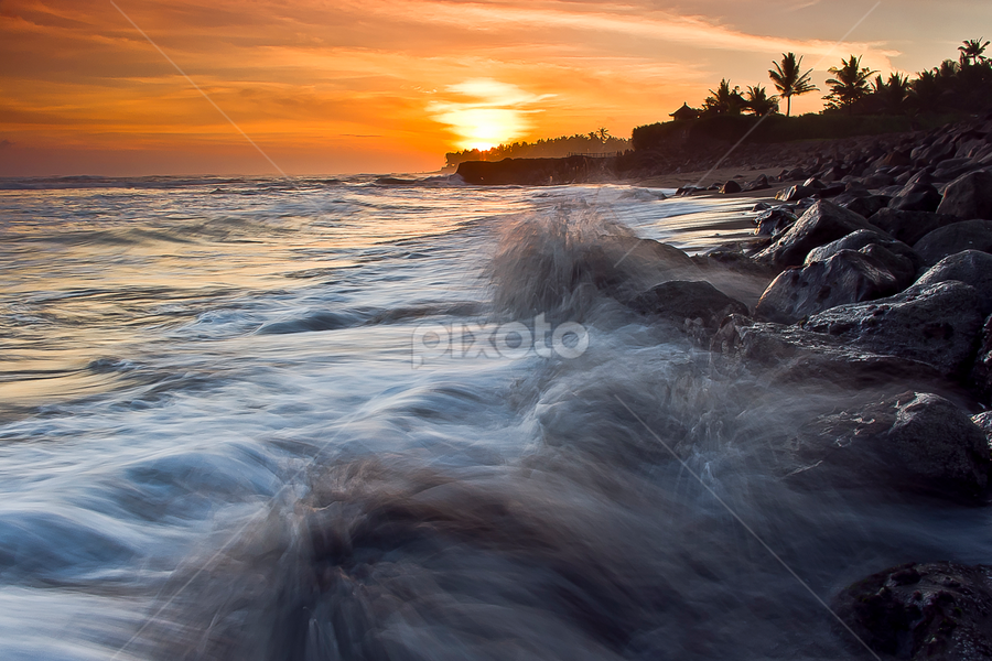 Three  by Choky Ochtavian Watulingas - Landscapes Sunsets & Sunrises ( clouds, boulders, splashing, sunset, waves, beach, seascape, splashed, motion, rocks, sun )