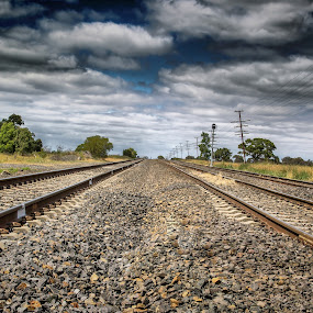 The end of the line by John Torcasio - Landscapes Travel ( clouds, train tracks, power lines, cloudy, rocks, john torcasio,  )