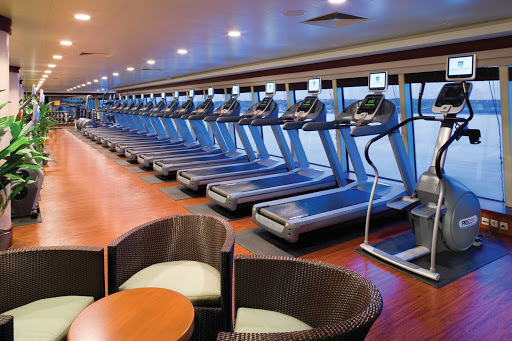 Norwegian-Pearl-Fitness-Center - Work up a sweat while enjoying the floor-to-ceiling window view at Norwegian Pearl's Body Waves Fitness Center.