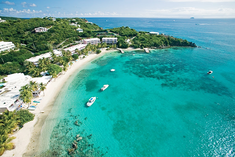 Boats are anchored in the bay near Secret Harbour on St. Thomas, US Virgin Islands.