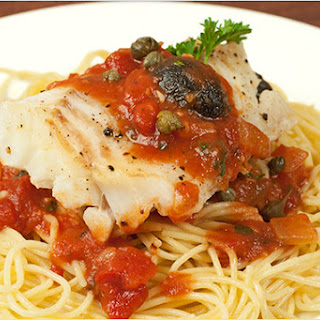 Broiled Cod With Puttanesca Sauce.