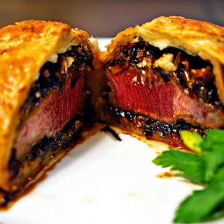Individual Beef Wellingtons with Caramelized Onions and Bleu Cheese Rosemary Compound Butter