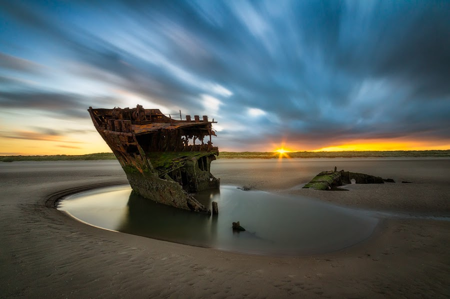 Baltray by Rafal Rozalski - Landscapes Beaches ( clouds, ireland, shipwreck, wreck, sunset, long exposure, beach, landscape, baltray, sun, rrphoto, rozalski )