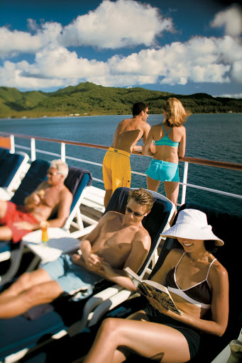Bask in the Polynesian sunshine on the pool deck aboard the Paul Gauguin.