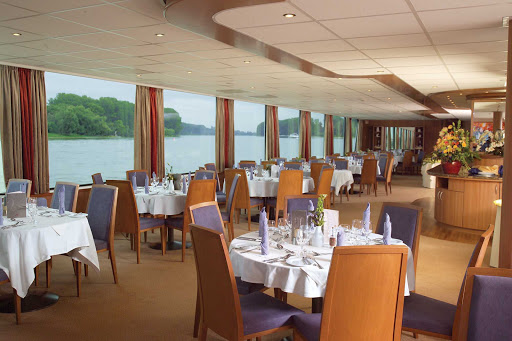 Viking-Helvetia-Dining-Room - Dine in Viking Helvetia's restaurant while soaking up the evening vistas of the Rhine River.