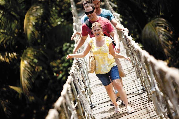 Cruise Norwegian Jewel to Honduras and take a thrilling stroll across Gumbalimba Park's Roatan Suspension Bridge.