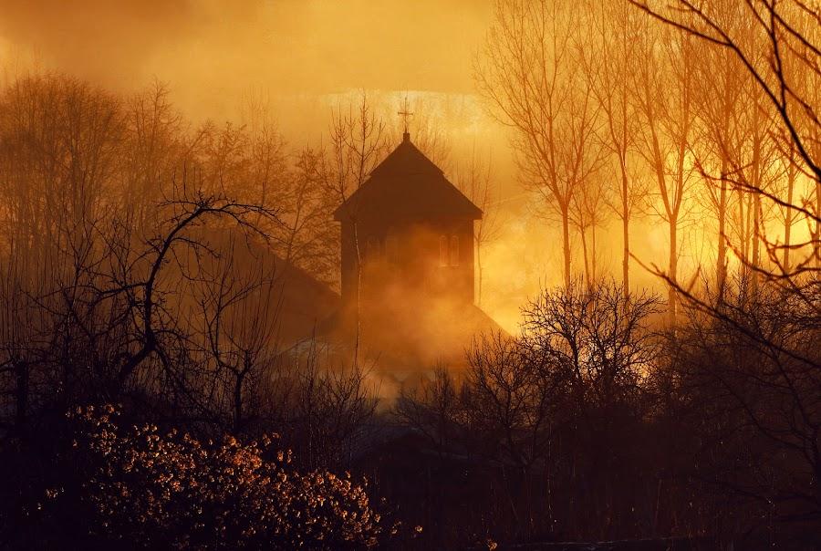 the hidden monastery by Bogdan Vasilescu - Buildings & Architecture Places of Worship ( orange, building, faith, romania, architecture, varbila, worship, smoke, religion, fog, monastery, trees, sunrise, light, branches, mist )